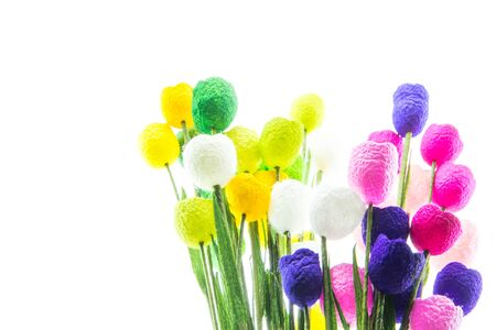 Colorful of decoration artificial flowers created from the cocoon  an isolate on white background