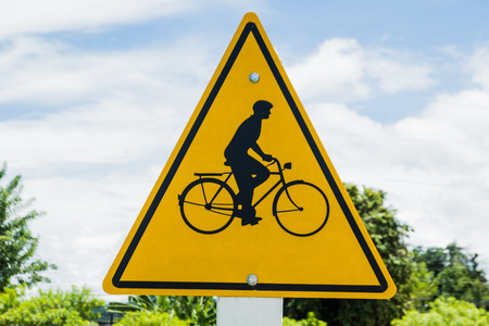 one lane road sign: Bicycle traffic sign in a traditional yellow triangle