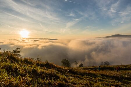 Many people are watching the morning sunrise beauty on view point at Phuhinrongkla National Park  Phitsanulok, Thailand. Stock Photo