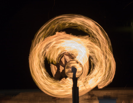 Fire dancing show fireball show amazing at night. Swinging fire in full moon thailand. Stock Photo
