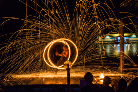 Fire dancing show fireball show amazing at night. Swinging fire in full moon thailand. 에디토리얼