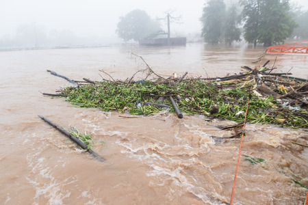 The water come through Flash flood The impact of global warming The major cause heavy flooding. Including the impact of deforestation. Stock Photo