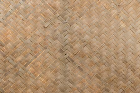 Traditional handcraft weave Thai style pattern nature. texture bamboo surface for furniture material. Bamboo wickerwork  background.