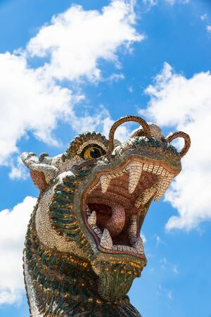 The flying lion statue in the fairy tale with  blue sky in watpahuayrad  Phu-Rua  Loei Province ,Thailand