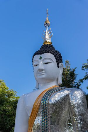 The standing buddha statue with  blue sky background. Loei, Thailand