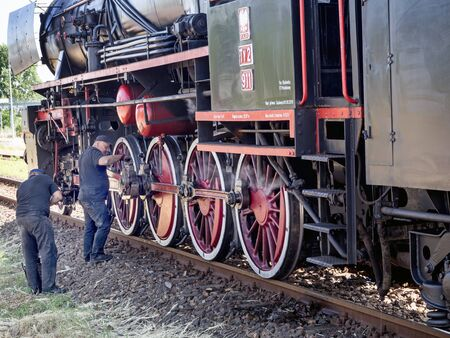 WADOWICE RAILWAY STATION, POLAND – JUNE 29, 2019, - steam locomotive PKP classes Ty2 during oiling.