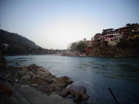 Ganges Riverbank clean water flowing in rishikesh, India