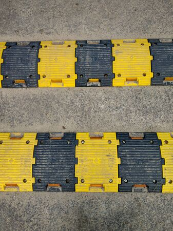 Plastic made yellow and black speed breaker