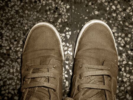 Top angle view of sneaker photograph on the floor