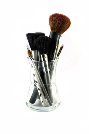 Makeup tools in the glass photo