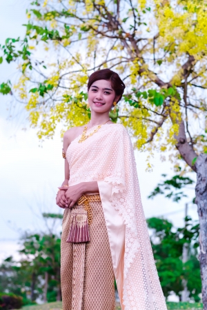 woman wearing typical thai dress photo