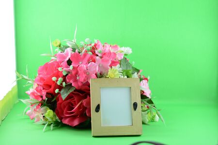 photo frame and flowers photo