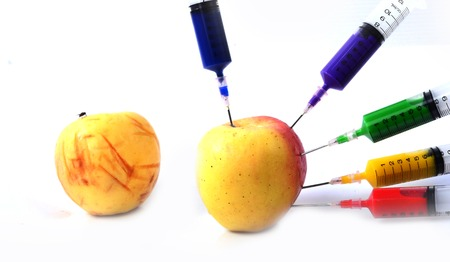 Apple and syringes isolated photo