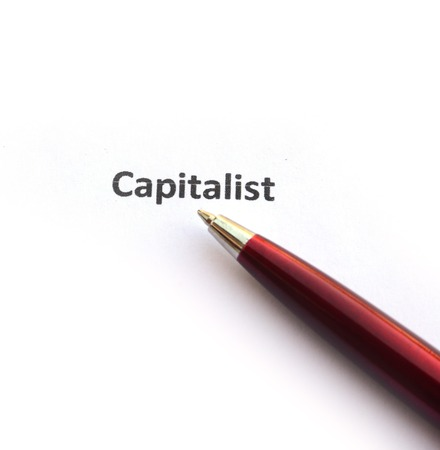 capitalist: Capitalist with pen Stock Photo