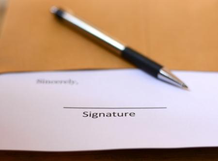 signature with pen photo