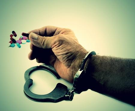手錠を抱きかかえた医学 写真素材