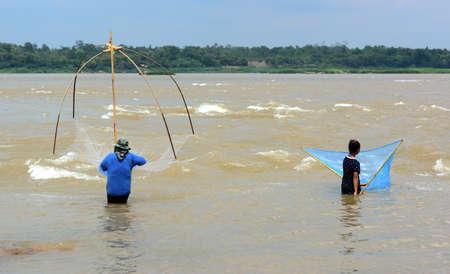 fishing nets on the Mekhong river photo