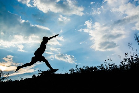 little boy jumping to sky and having happy time, Sillhouette concept