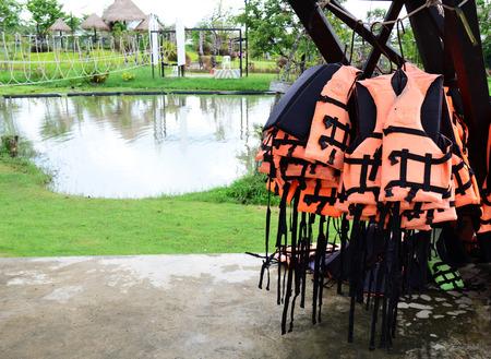 flotation: orange lifejackets  on playground Stock Photo