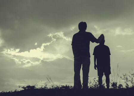 Father and son looking for future,  silhouette concept photo