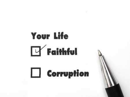 Your select is Faithful or Corruption, ink print,check Faithful Stock Photo