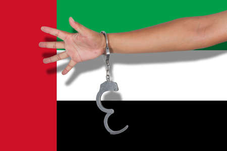 hand cuff: handcuffs with hand on  United Arab Emirates flag