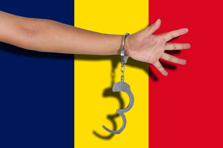 chad flag: handcuffs with hand on Chad flag
