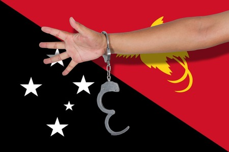 hand cuff: handcuffs with hand on Papau New Guinea flag