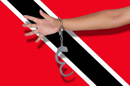 hand cuff: handcuffs with hand on Trinidad and Tobagoh flag