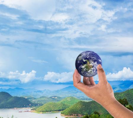 glowing earth: holding a glowing earth globe