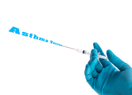 intramuscular: Hand in a blue glove holding syringe with Asthma vaccine text isolated on white