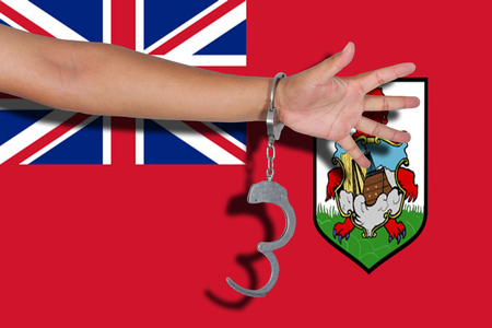 bermuda: handcuffs with hand on Bermuda flag