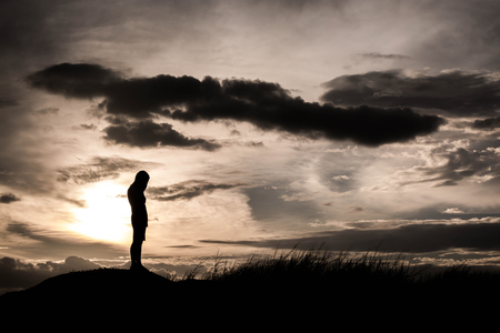 grudge: Boy standing grudge on sunset view, silhouette concept