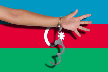hand cuff: handcuffs with hand on Azerbaijan flag