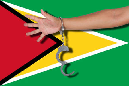 hand cuff: handcuffs with hand on Guyana flag