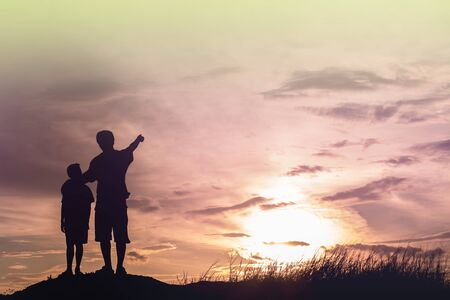 adult hand: Father and son looking for future,  silhouette concept Stock Photo