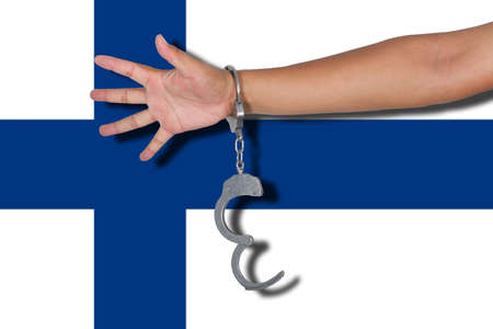 finland flag: handcuffs with hand on Finland flag