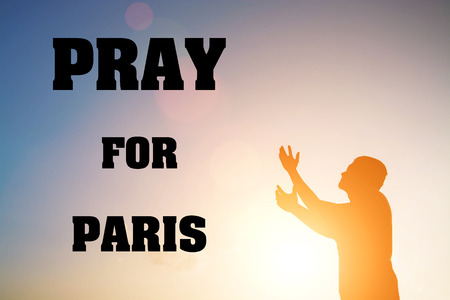 shootings: Silhouette of man pray there is hope with text Pray for Paris Stock Photo