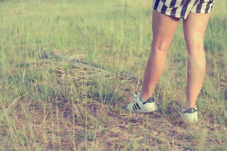 enjoying life: woman enjoying life standing in a grass field