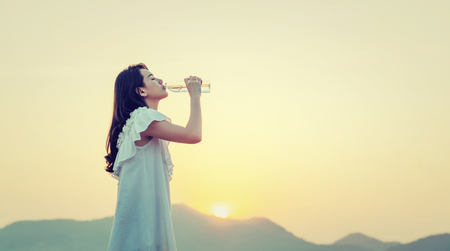 Woman drink water for thirst