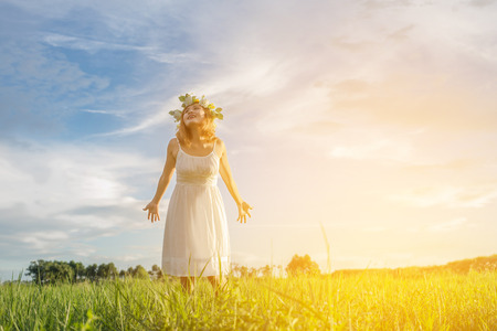 Freedom concept : Young beautiful woman enjoying with fresh air and nature at meadows. Stock Photo
