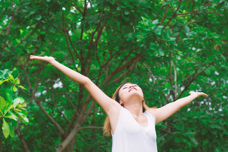 happy woman standing stretch her arms in the air. Enjoy fresh air.