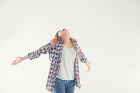 Freedom young hipster woman raising hands with isolated over a white background.