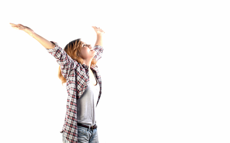 happy hipster elated woman with arms out raised up isolated on white background in studio.