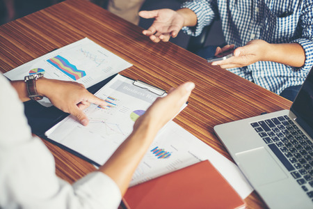 Close-up of  Team Business people discussing a financial plan at office. Stock Photo