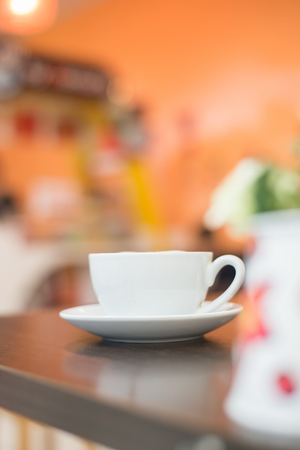Cup of cappuccino at coffee shop background. Imagens