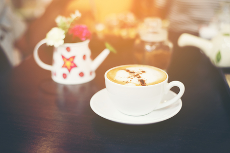 Cup of cappuccino at coffee shop background.  Stock Photo