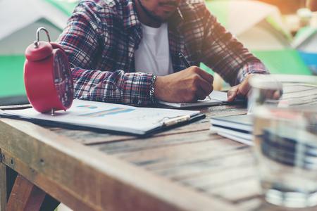 determine: Hipster Businessman Working writing Determine Workspace Lifestyle Concept. Stock Photo