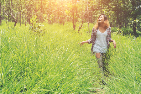 Young woman enjoying nature in the middle of a meadow, Freedom and relaxing. Stock Photo