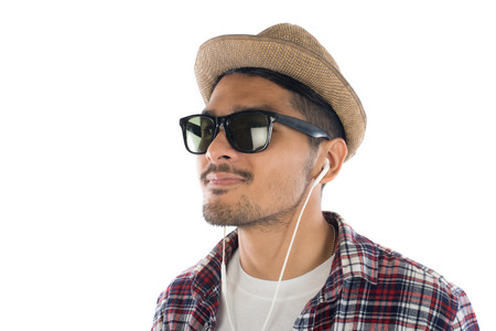 Young hipster man in earphones holding smartphone isolated on the white background.
